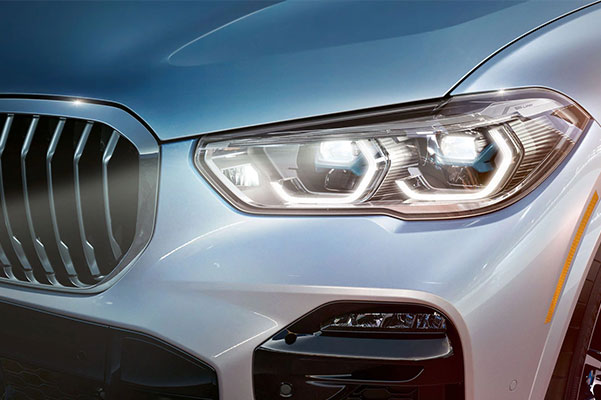close up of BMW x5 suv headlights
