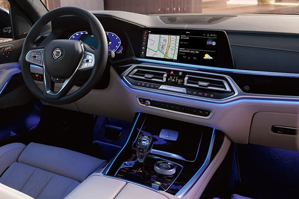 Interior close-up of BMW X7 available Glass Controls, heated front armrests, and premium leathers