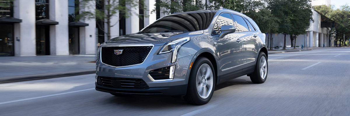 2021 Cadillac XT-5 in stain steel metallic driving down street