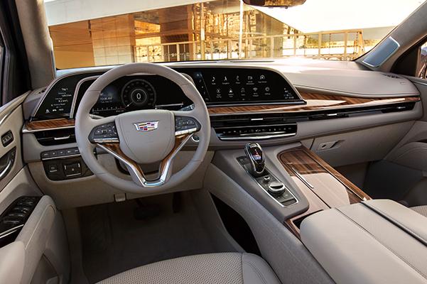 2021 Escalade Premium Luxury; exterior color featured in Dark Mocha Metallic; RWD; short wheel base; interior image; steering wheel; front and middle consol;