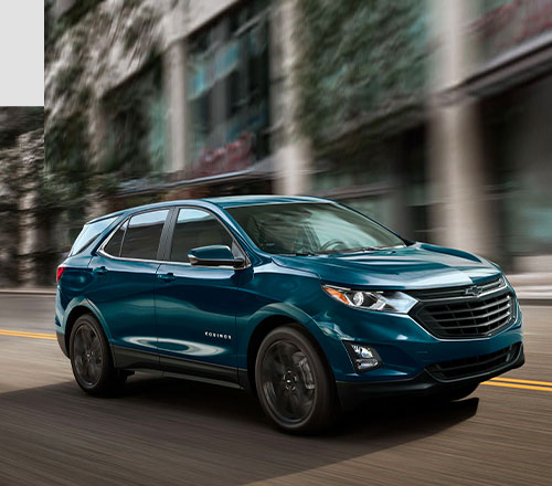 blue 2021 chevrolet equinox suv on the road at high speed on street