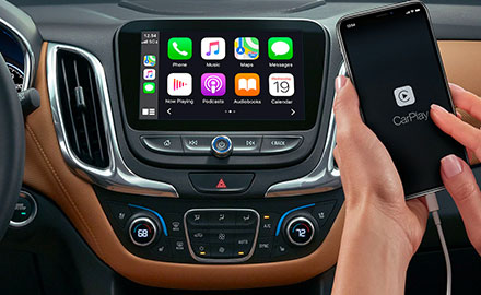 interior view of 2021 chevrolet equinox showcasing apple car play on the digital screen