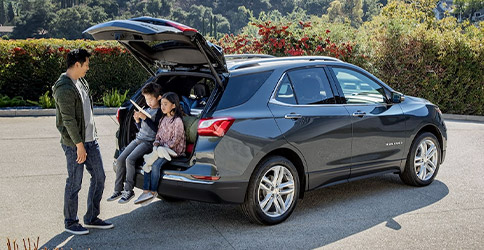 Children sitting in back hatch of 2021 Chevy Equinox