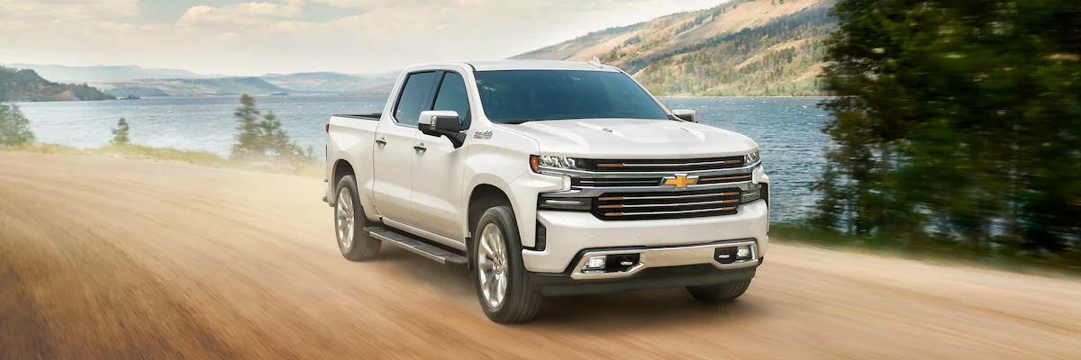 2021 Chevy Silverado 1500 driving down dirt road by water