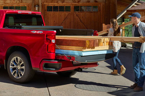 2021 Chevy Silverado 1500 being loaded with lumber