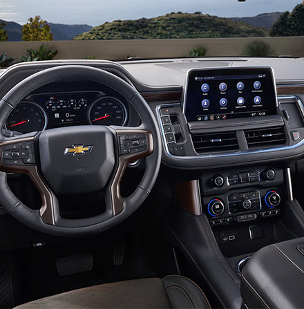 interio view of chevrolet suburban showcasing driver's dashboard and digital screen