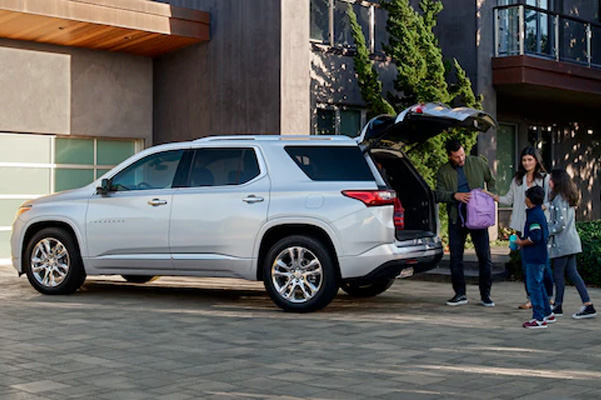 2021 Chevy Traverse trunk open with family