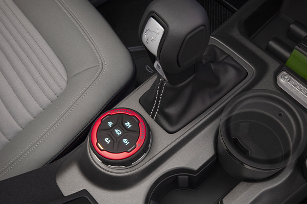 Close up of 2021 Ford Bronco interior shifter and cupholders