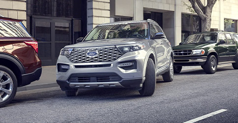 A 2021 Ford Explorer in Iconic Silver parallel parking in between two other Explorers