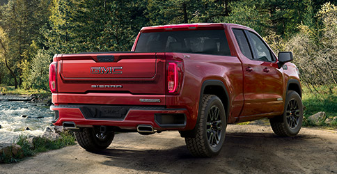 Rear shot of the 2021 GMC Sierra 1500 parked by a river