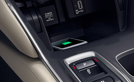 a smarth phone being charged wirelessly on the 2021 honda accord