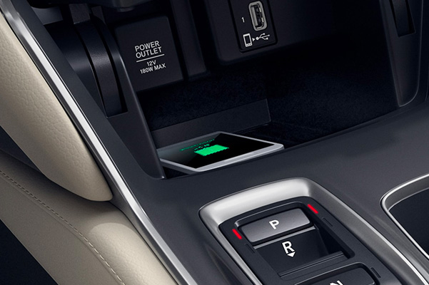 a smart phone being charged wirelessly on the 2021 honda accord