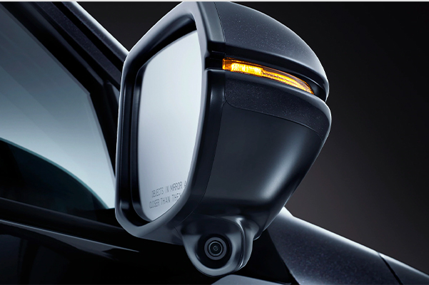 Detail view of Honda LaneWatch™ camera on passenger-side mirror on the 2021 Honda HR-V EX-L in Crystal Black Pearl.