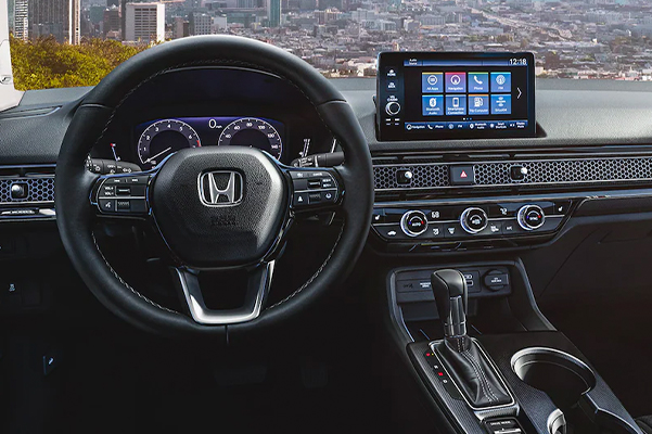 Interior view of the 2022 Honda Civic Touring Sedan with Black Leather, with a city skyline visible through the windshield.