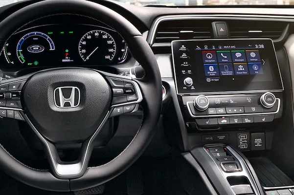Interior view of steering wheel and dash on 2022 Honda Insight Touring with Ivory Leather.