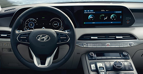 interior view of hyundai pasidale suv showcasing drivers dashboard and digital screen