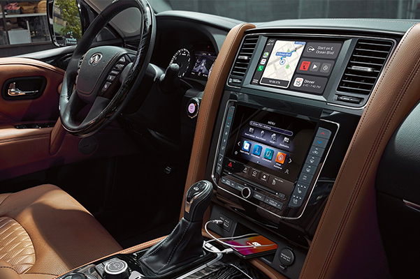 2021 INFINITI QX80 SUV | Interior View of Center Console Highlighting Apple CarPlay Integration