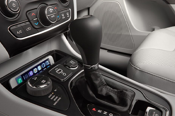 A close-up of the center console in the 2021 Jeep Cherokee.