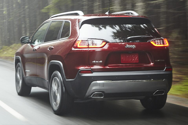 A 2021 Jeep Cherokee being driven on an open road.