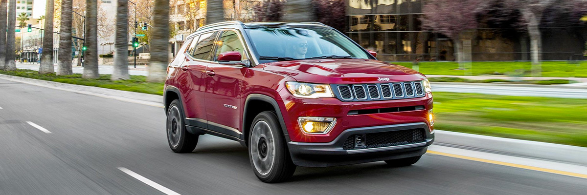 The 2021 Jeep Compass being driven on a city street.