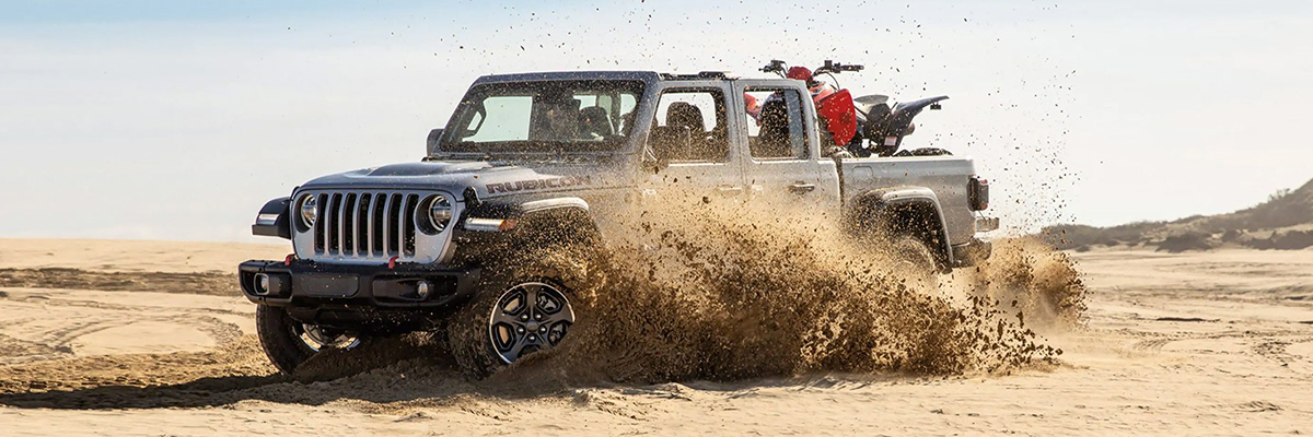 2021 Jeep Gladiator driving in the sand