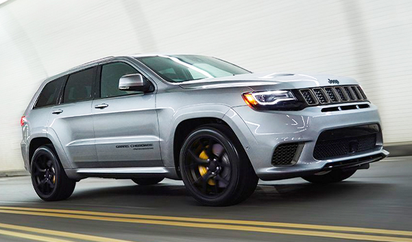 he 2021 Jeep Grand Cherokee driving high speed.