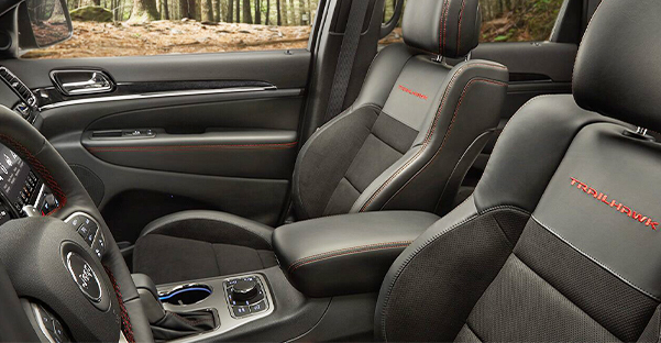 An interior view of the driver and front passenger seats in the 2021 Jeep Grand Cherokee Trailhawk.