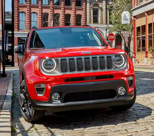 2021 Jeep Renegade red in city setting