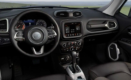 The front seats and red center console with transmission shifter on the 2021 Jeep Renegade, viewed from above.