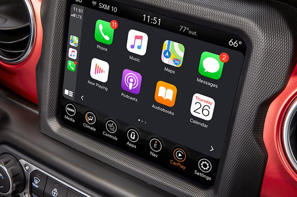 A close-up of the Uconnect touchscreen in the 2021 Jeep Wrangler Rubicon, displaying Apple CarPlay selections.