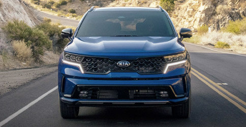 2021 Kia Sorento in blue driving down a highway through desert terrain, front view