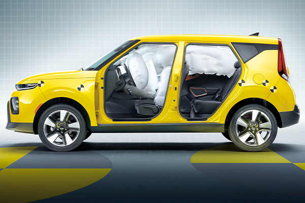 Safety airbags shown inside yellow Kia Soul