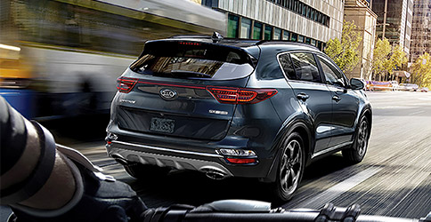 rear view of the 2021 kia sportage on a road in the city