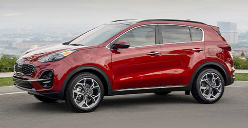 2021 red kia sportage parked on the road