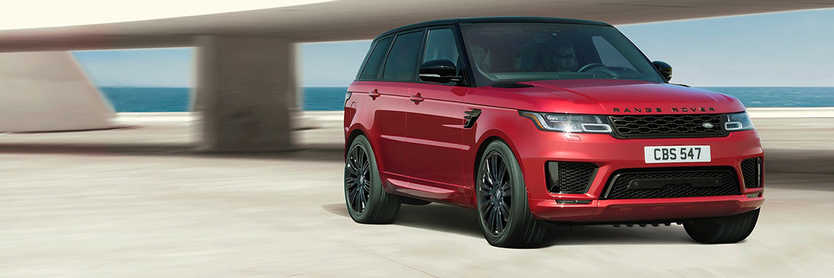 2021 Range Rover Sport parked on a sleek driveway overlooking the ocean
