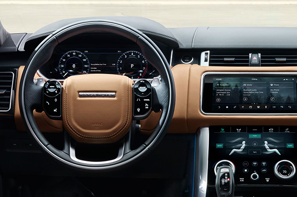 Interior dashboard of a 2021 Range Rover Sport with touchscreen and dual climate control