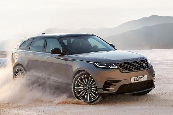 Range Rover Velar driving on a rocky desert terrain.