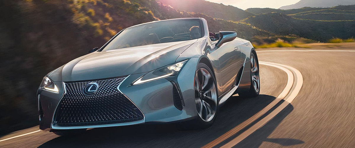 2021 Lexus LC 500 Convertible driving down a scenic road