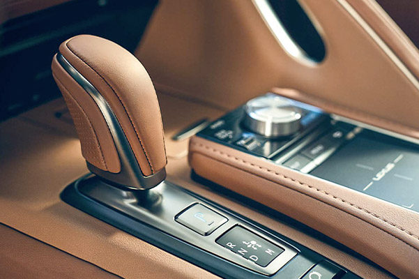 Interior of the Lexus LC showing the leather shift knob in Toasted Caramel leather.