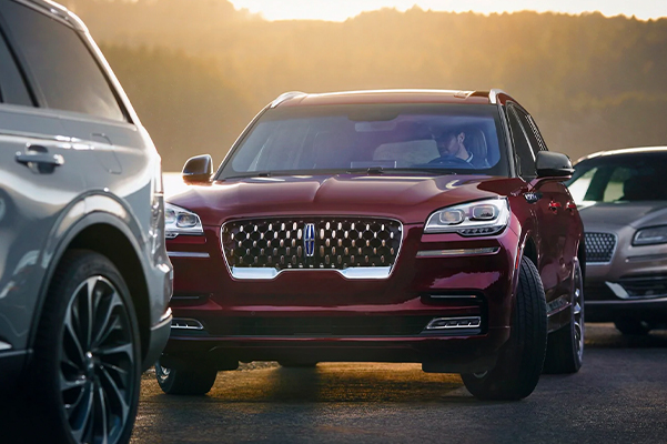 A 2021 Lincoln Aviator is shown as the vehicle parks itself between two other vehicles