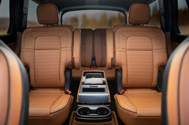 The interior of a 2021 Lincoln Aviator in the Flight theme is shown from the front row looking backward to the third row