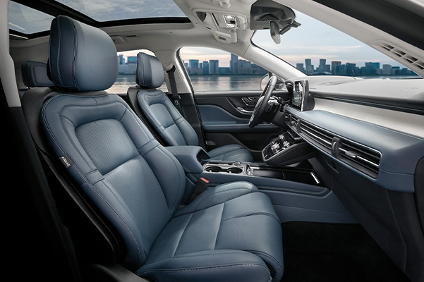 The Beyond Blue interior of a 2021 Lincoln Corsair shows a color palette of deep blue and black materials with white stitching and floating chrome