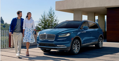 2021 Lincoln Nautilus with couple walking in front of it