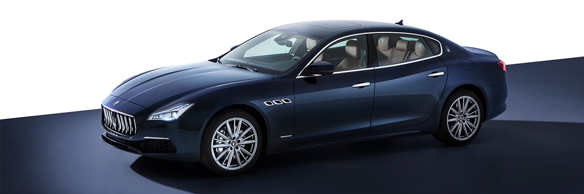 3/4 side view of a blue 2021 Maserati Quattroporte