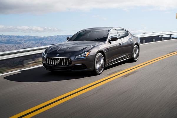 2021 Maserati Quattroporte driving down the road