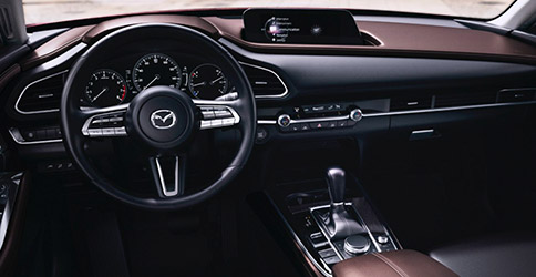 interior shot of Mazda CX-30 suv featuring driver dashboard and digital screen