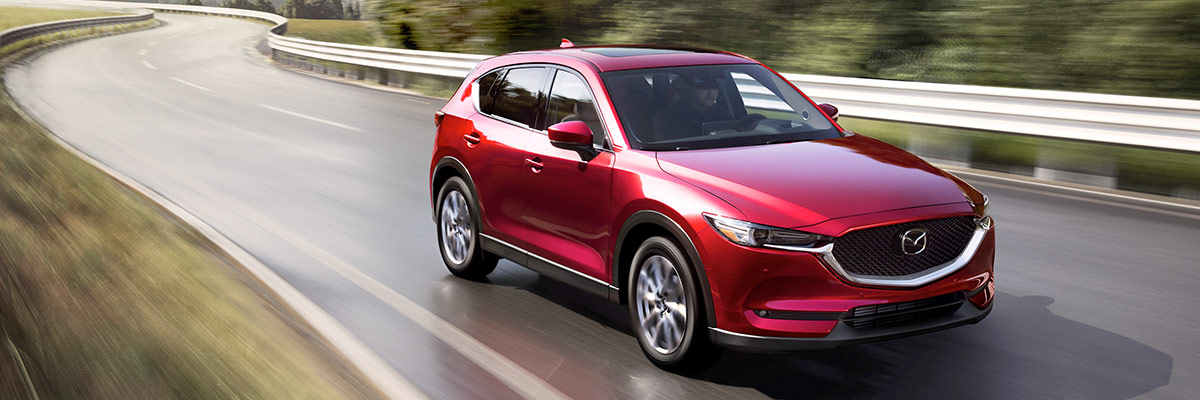 Red 2021 Mazda CX-5 on road