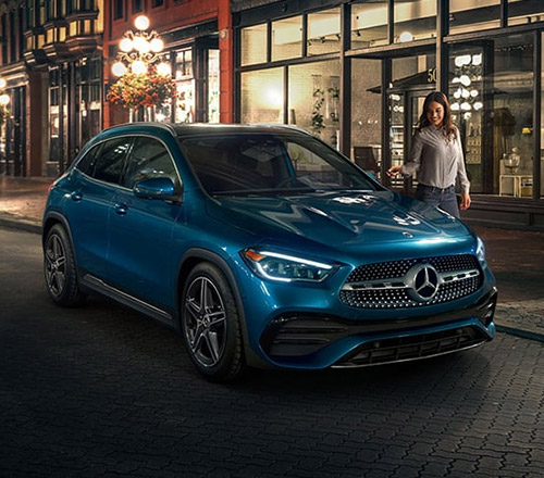 blue Mercedes Benz gla crossover parked on the street in front of a restaurant