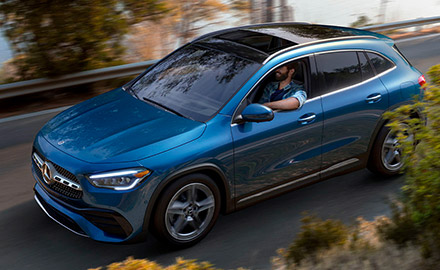 a man driving a blue mercedes benz gla crossover with the windows down