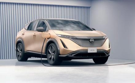 Nissan Ariya charging at station